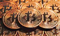 区块链:比特币连涨11天 重回7000美元 资金流向虚拟货币?